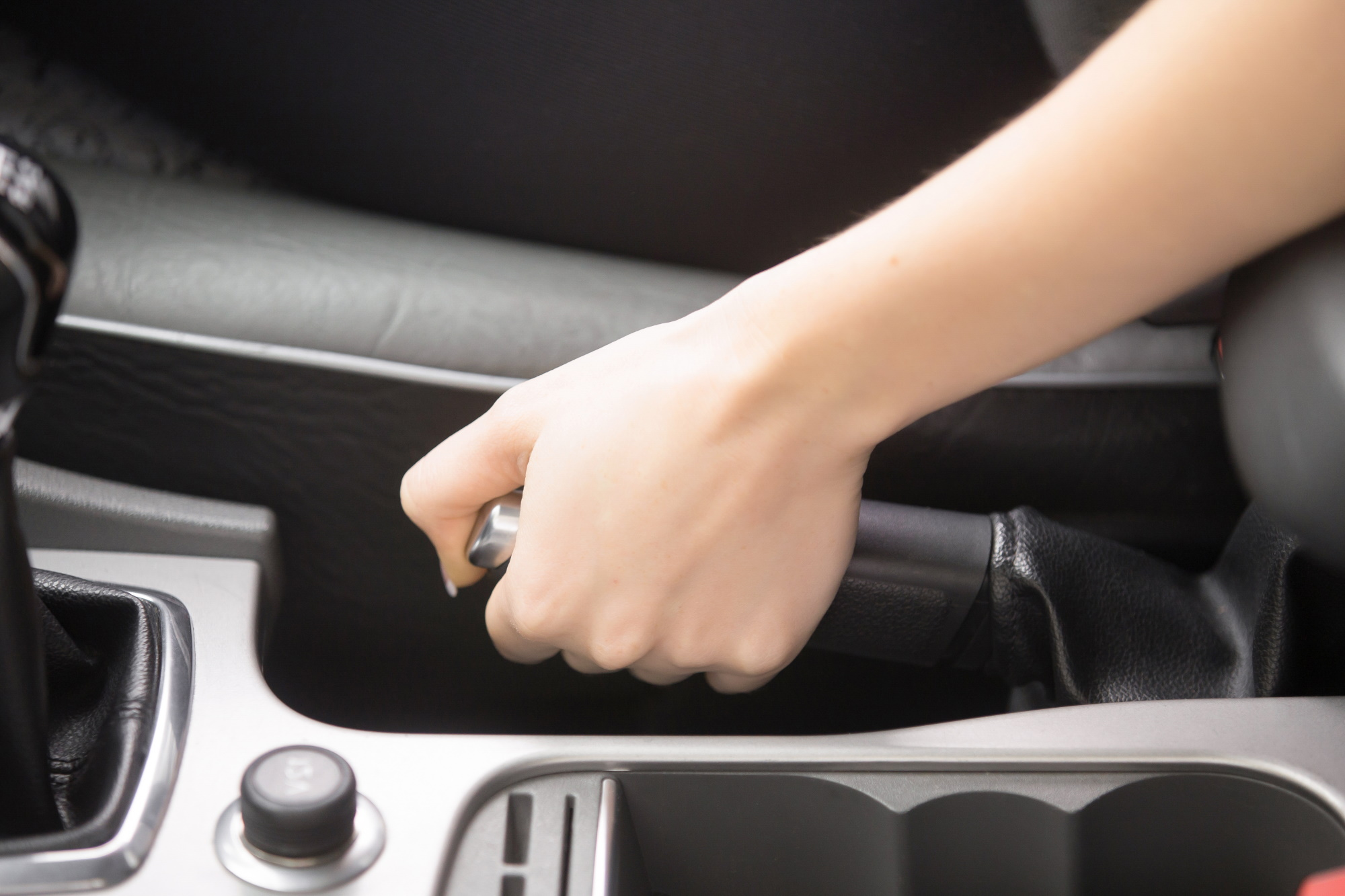 close-up-female-hands-holding-handbrake